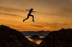 an active woman jumping