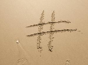 hashtag sign written on sand