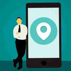 clipart of a man standing on phone with GPS